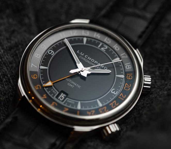 The orange hour markers are striking on the black dial.